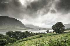 Stormy day. (DigitalAutomotive) Tags: thelakedistrict july2016 buttermere cumbria crummockwater stormyday wetweather clouds lake green water trees treeline fence vista view lakes england englishtourism visitengland visitingthelakedistrict weather englishweather whatevertheweather
