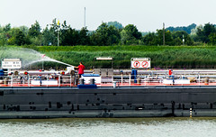 "Testing the fire gear onboard MTS (Motor Tank Ship) ""Atlantis "" (Eduard van Bergen) Tags: art picture still photograph foto lek rhine rijn holland dutch netherlands niederlande pays bas river riverbank water swimsuit outdoor boat vehicle rotterdam rural city reed riet boats boote bateaux schiffe schepen boten streaming meander breakwater wind back time sun light crowd beaken sign people mass mt tanker fire gear canon jet atlantis molenwaard alblasserwaard liesveld krimpenerwaard fleuve courant rio"