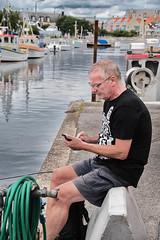 By the dock (Maria Eklind) Tags: smbtshamn water spegling sweden boats clouds summer limhamn resund malm outdor dof himmel sky depthoffield hamnfestivalenlimhamn djup harbour reflections skneln sverige se