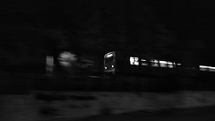 untitled (ChrisRSouthland (away and mainly off for several w) Tags: night nightimage nightshot urban city athens bw train monochrome mm mmonochrom leica elmarit28mmf28 motion motionblur