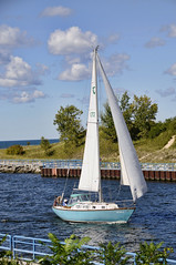 Sailing into the channel (John Rothwell) Tags: sail boat whitehall muskegon michigan water channel yacht summer late latesummer september blus