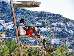"Enjoying beach resort ""Roses"" (Costa Brava), Catalunya, Spain - Life guard on duty (jackfre 2) Tags: spain roses resort beachresort catalunya sea hotels beaches lifeguard onduty"