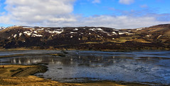 how to energise an Icelandic fjord?! (view large pls) (lunaryuna) Tags: iceland northwesticeland westfjords landscape panoramicviews fjord mountains spring season seasonalchange water reflections sky clouds weathermood powerpoles lowtide road travel snow lunaryuna