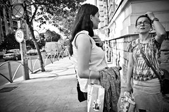 That's a Complicated Answer... (stimpsonjake) Tags: nikoncoolpixa 185mm streetphotography bucharest romania city candid blackandwhite bw monochrome women talking discussion scratchinghead
