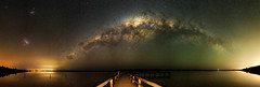 Milky Way over Lake Clifton, Western Australia - 35mm Panorama (inefekt69) Tags: lake clifton mandurah reflections water panorama stitched mosaic microsoft ice milkyway cosmology southernhemisphere cosmos southern westernaustralia australia dslr longexposure rural nightphotography nikon stars astronomy space galaxy astrophotography outdoor milky way core great rift ancient sky 35mm d5100 magellanicclouds large small magellanic cloud night airglow jetty pier explore explored