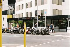 Scooter Gang (Denzel De Ruysscher) Tags: film pentax explore colour 35mm scooter motorcycle city wellington street