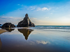 Into The Sky (intrazome) Tags: ocean travel sea cliff reflection beach water rock reflections mirror coast sand nikon rocks cornwall day cliffs coastline bedruthan bedruthansteps d5100 pwpartlycloudy