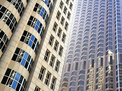 Sky Castle (misterbigidea) Tags: sf sanfrancisco urban reflection building castle window glass stone skyline architecture corner buildings grid downtown pattern steel bank lookup financial skyscaper towering crowded closingin