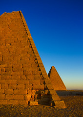 The Pyramids At Jebel Barkal, Used By Napatan Kings, Karima, Sudan (Eric Lafforgue) Tags: africa travel blue sunset sky history archaeology cemetery vertical architecture outdoors photography sand ancient day desert pyramid northafrica soedan african sudan tomb dry sunny unescoworldheritagesite mausoleum ancientcivilization nubia thepast karima oneperson clearsky ruined soudan tranquilscene saharadesert northernafrica traveldestinations colorimage famousplace meroitic oldruin aridclimate  1people szudn sudo jebelbarkal  northernsudan placeofburial northsudan blackpharaohs     kushitic  xuan eri7268