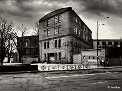 Arsenal Factory (t-maker) Tags: road street city sky people urban blackandwhite bw cloud white plant black building men history industry apple window lamp monochrome architecture clouds fence town women gate industrial factory pavement military optical ukraine historic company sidewalk soviet lantern enterprise facility kiev economy arsenal kyiv roadway optics iphone manufacturer iphoneography