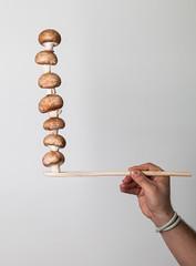 mushrooms escaping gravity (Valerio Loi) Tags: white mushroom escape hand finger nail spoon minimal gravity bracelet mano balance wrist possible simple balanced impossible equilibrium braccio equilibrio fungo defy