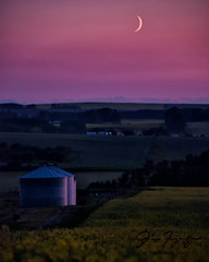 Fingernail Moon And Grain Bins (johnfuj) Tags: sunset moon canada thing object smoke objects cigar things crescent alberta carstairs prairie agriculture canola prairieprovinces smokingobjects