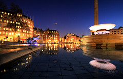 Blue Hour Reflections at Trafalgar Square in London (` Toshio ') Tags: city blue england london water fountain statue architecture buildings reflections gold lights evening europe european cityscape unitedkingdom trafalgarsquare bluehour europeanunion cityoflondon toshio