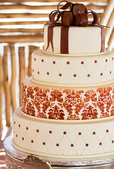 Layered white wedding cake with chocolate detail (noscasamosbo) Tags: wedding party food brown white detail classic love beautiful cake closeup silver table southafrica dessert happy groom bride three colorful candy br