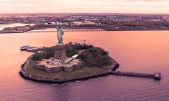 Liberty Island (Caterix) Tags: holidays newyork color sunset ladyliberty eastcoast city fromtheair helicopterflight libertyisland colour helicopter shine natural light northamerica beautiful vivid citythatneversleeps newyorkcity lighting bigapple statueofliberty usa landscape golden america
