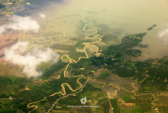 Aerial View of the Mekong Delta in Southern Vietnam (fesign) Tags: aerialview architecture brown buildingexterior city cloudsky colourimage curves day horizontal mekongdelta nopeople orange outdoors photography river rivermekong traveldestinations vietnam