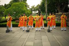 Orange Players (Andrea_b.) Tags: 2014 citadel fujixpro1 hue mood musicplayers orange people socialdocumentary street urban vietnam