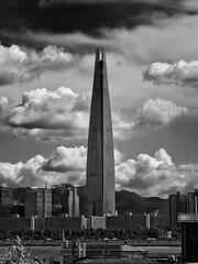 Barad-dr (EmreKanik) Tags: lotteworldtower cloudporn seoul asia monochrome tower foreboding southkorea blackandwhite cityscape skyscraper skyline baraddr korea kr lensbaby