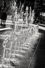 Waterworks (vinnie saxon) Tags: water people street blackandwhite monochrome bokeh nikoniste nikon d600