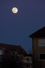 The moon (DavidAndersson) Tags: above moon buildings evening sweden vnersborg tamron18200f3563
