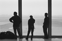 three men (jeffsongesq) Tags: film silhouette 35mm airport ilford gimpo