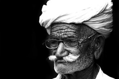 The Little Moustache (Rajagopalan Sarangapani) Tags: india photography flickr oldman moustache portraiture specs pushkar bnw thatha cwc rajasathan chennaiweekendclickers rajagopalansarangapani rjclicks
