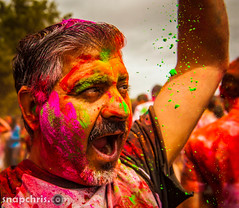 Man with green paint drops at Asha Stanford Holi Festival 2013 (tibchris) Tags: festival fun paint indian smiles stanford asha holi 2013 snapchris