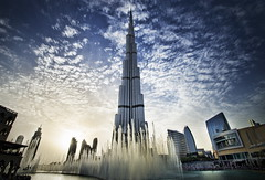 1,483 Feet (Greg - AdventuresofaGoodMan.com) Tags: city sunset urban lake building fountain skyscraper pond dubai uae middleeast landmark manmade unitedarabemirates dubaimall burjkhalifa
