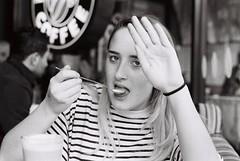 Sister, coffee drinker (David W T Powell) Tags: uk portrait blackandwhite bw costa film coffee sarah 35mm manchester lomo lomography kodak sister stripes trix drinking olympus om10 400tx 135 marketstreet olympusom10 filmphotography tx400 shootfilm kodaktx400 istillshootfilm choosefilm believeinfilm