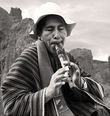 Flautist in the valley of the moon (goddessofxanadu) Tags: bolivia poncho lapaz traditionaldress valleyofthemoon flautist flutemaker aymaraman