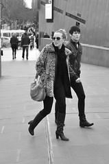 Don't Look Back (Smith-Bob) Tags: street city ladies friends people bw woman sunglasses lady blackwhite women couple boots candid citylife melbourne shades chic blacknwhite sunnies animalprint