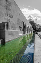 Aqua Dementia (Anthony Pallotto Photography) Tags: blue sky people bw white black color green monument water clouds switzerland nikon geneva statues mastodon selective 1536 d7000 aquadementia