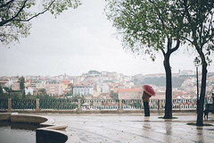 . (joannablu kitchener) Tags: portugal rain umbrella evening lisboa lisbon streetphotography streetlife stranger portugese