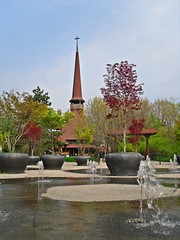 The church from the park (Ramona R***) Tags: park parque trees parco primavera church fountain spring cross branches iglesia kirche chiesa pot pots cruz igreja romania titan orthodox fontana fontaine glise parc fonte bucharest printemps vaso bucuresti biserica rumania cruce croix woodenchurch roumanie ior maceta orthodoxchurch bucarest primavara pitchedroof bisericaortodoxa tallchurch iorpark parculior orthodoxarchitecture parculalexandruioancuza bisericapogorareasfantuluiduh alexandruioancuzapark