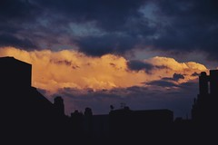 Desvo (JavierAndrs) Tags: city blue light sunset sky orange storm color luz colors rain weather silhouette azul clouds buildings atardecer lluvia edificios nikon colours view ciudad colores f45 telephoto 55mm cielo nubes hoy tormenta vista silueta nikkor today crdoba naranja clima teleobjetivo d3100