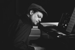 Passion (Mathijs Delva) Tags: light portrait bw music playing man classic monochrome person mono blackwhite grain piano naturallight indoor passion grainy enjoying windowlight passionate oldpiano playingpiano 100mmf28macro