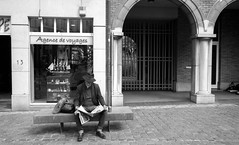 """Place de la vielle halle aux bls, Brussels (Sailing """"Footprints: Real to Reel"""" (Ronn ashore)) Tags: man read newspaper elderly street arches travel bw people dream brussels belgium leicam7 leica35mmf28summary film adoxsilvermaxinxtol xtol europe rangefinder 35mm"""