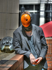 A Little Creepy (swong95765) Tags: mask creepy different man odd spiral unusual orange eye