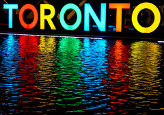 A Reflection of Toronto (A Great Capture) Tags: ig agreatcapture agc wwwagreatcapturecom adjm toronto on ontario canada canadian photographer northamerica ash2276 ashleylduffus ald mobilejay jamesmitchell summer summertime 2016 rainbow torontosign 3d sign night city hall nathan phillips square neon lights icon iconic reflection colourful colorful colours colors downtown water share3dto nathanphillipssquare cityhall fountain tourist attraction litup to the6ix blue red yellow green orange