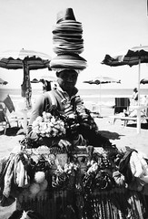 the beach seller (enrico vattani) Tags: beach seller lomo lca black white