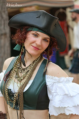 Redheaded Pirate Wench (wyojones) Tags: usa beautiful beauty smile look hat festival nose necklace eyes texas expression makeup paige lips blouse redhead greeneyes belly pirate faire earrings shoulders lovely renaissancefestival renaissance renfest maiden midriff wench piratehat girlwoman prettycute threecornedhat wyojones sherwoodforestfaire seagoingmauden