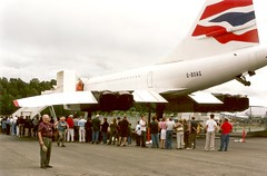 Concorde G-BOAG...Bill III points to the  subject of the photo (wbaiv) Tags: concorde aerospataile gboag british airways seattle boeing museum flight sst supersonic transport airliner airplane jet passenger commercial plane aircraft flying machine powered full size people smiles smile happy engaged eyes direct joy enjoyment persons men women work friends coworkers classicairliners 4engine fourengine outdoor vehicle port civil 4 engine