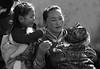 0892 A mother with two kids--Tongren , Qinghai Province , China (ngchongkin) Tags: china portrait harmony finegold thegalaxy flickraward flickrbronzeaward heartawards artofimages goldstarawardlevel1 vivalavidalevel1 musictomyeyeslevel1 theredgroup niceasitgets rememberthatmomentlevel1 thelooklevel1red lacasadinadiavale