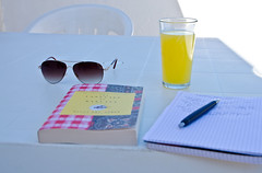 Italy 101 (sixthofdecember) Tags: travel italy glass sunshine sunglasses pen notebook table outside book chair nikon drink balcony stock pad notepad ballpen aranciata tamron18270 nikond5100 aranciataamara