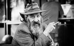 In beard and hat (Giulio Magnifico) Tags: portrait hat beard blackwhite cigarette streetphotography oldman smoker udine nikond800 nikkormicro105mmafsvrf28
