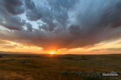 Virga Sunstar (kevin-palmer) Tags: summer july nikond750 tokina1628mmf28 color colorful sunset evening dusk virga storm stormy clouds weather gold golden sunlight orange grass sheridan wyoming sunstar