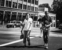 Touring By Couple (TMimages PDX) Tags: iphoneography photography image photo photograph streetscene fineartphotography geotagged people urban city street streetphotography portland pacificnorthwest sidewalk pedestrians buildings avenue road blackandwhite monochrome vignette