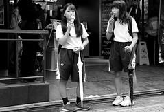 Sisters of ice creams (pascalcolin1) Tags: japan tokyo icecreams glaces soeurs sisters shorts parapluies umbrella photoderue streetview urbanarte noiretblanc blackandwhite photopascalcolin regards yeux eyes