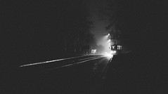 Grain Train (marcin baran) Tags: grain train tram way street tree trees urban city road lines light dark darkness lamps fog foggy atmosphere mood pov perspective night black white bw mono monochrome gliwice poland zabrze polska marcinbaran fuji fujifilm fujix100 x100 x100t awesome composition empty