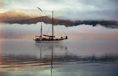 Beatitude (zebedee1971) Tags: lake water landscape boat ship cloud fog calm serene quiet mountains hills sunrise reflection reflect bird seagull sky land mast forest trees brilliant wow